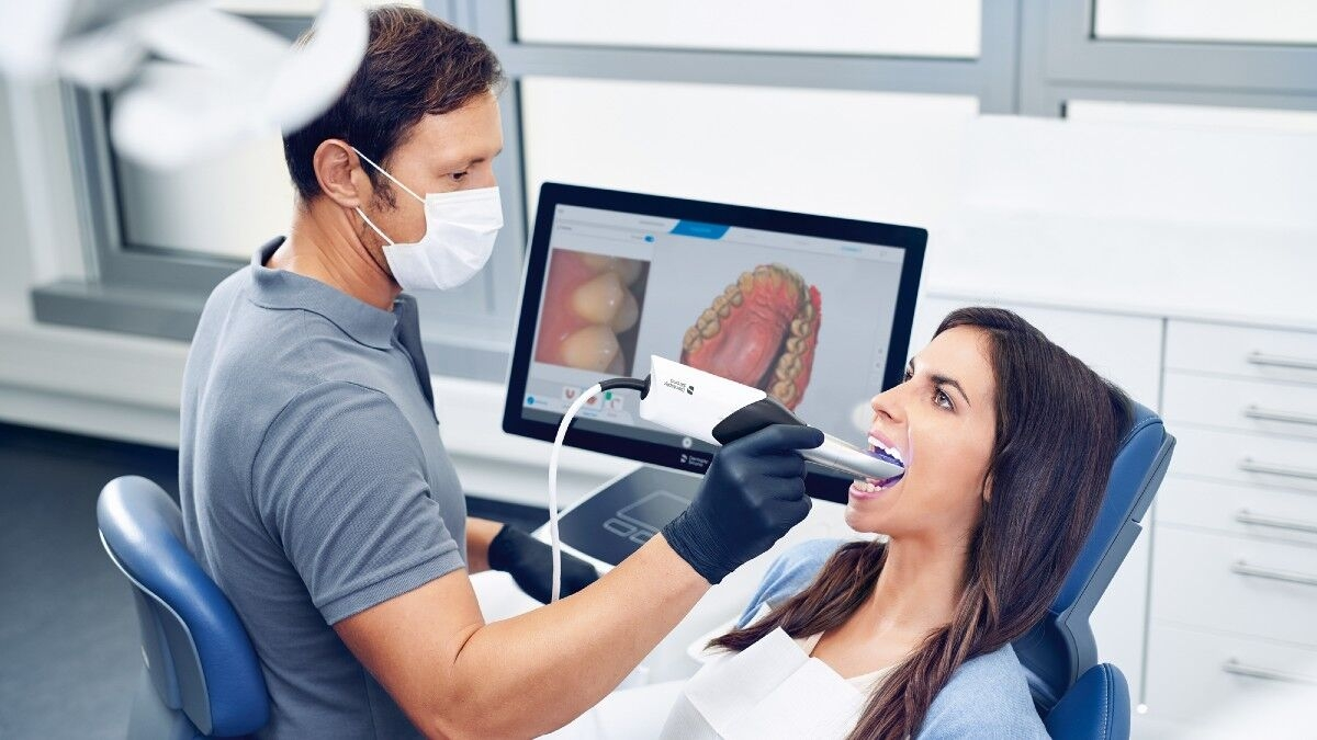 Dentist scanning patient with CEREC Primescan
