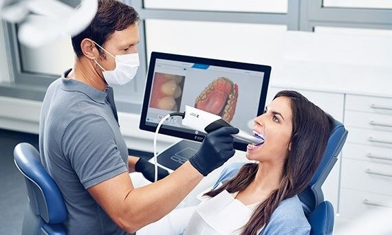Dentist taking digital impression with Primescan